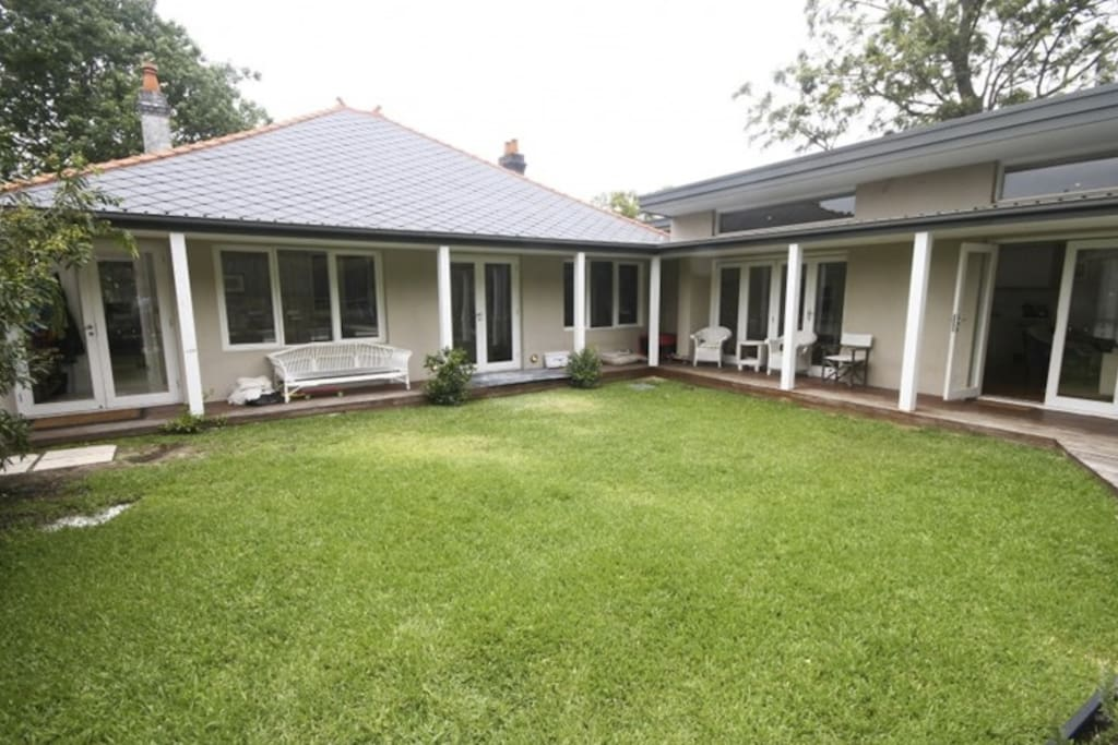 Large, enclosed family backyard backing on to pool. Large bi folding doors open from the family room and kitchen on to the backyard offering seamless entertaining areas.