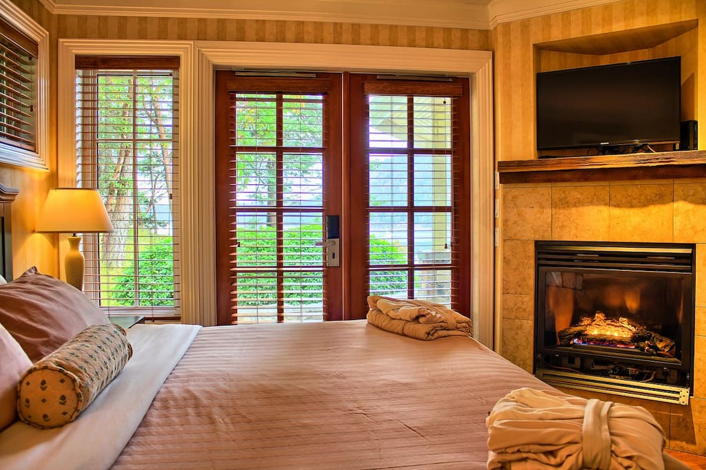 The master bedroom includes 1 king bed, 1 flat screen TV and a fireplace