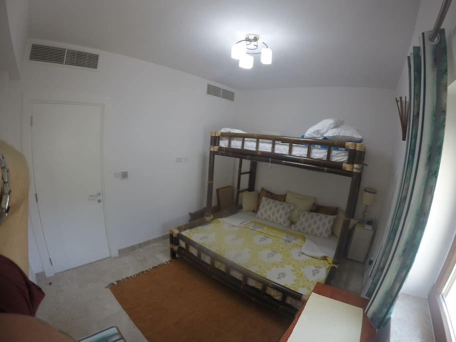 Down stairs bedroom with king size bed and bunks on top