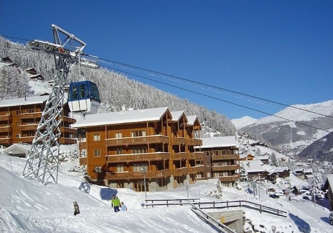 View of apartments from the bar across the piste.