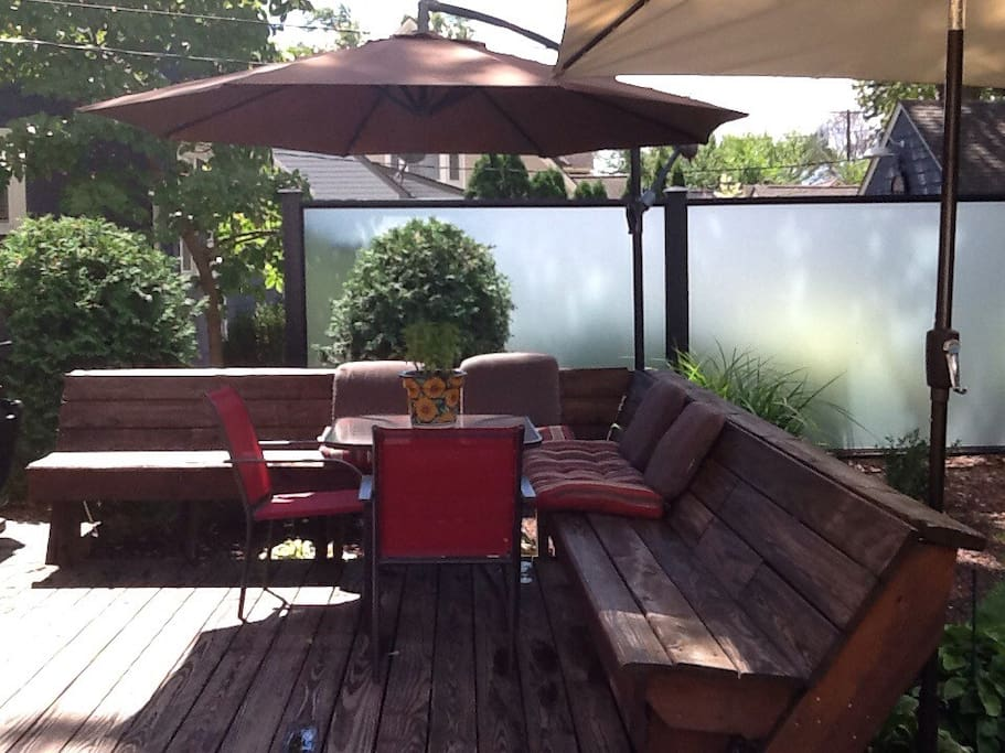 Private back deck with table and seating.