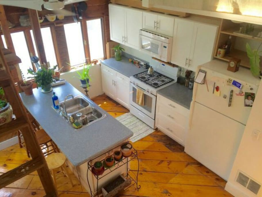 View of fully equipped kitchen from loft.