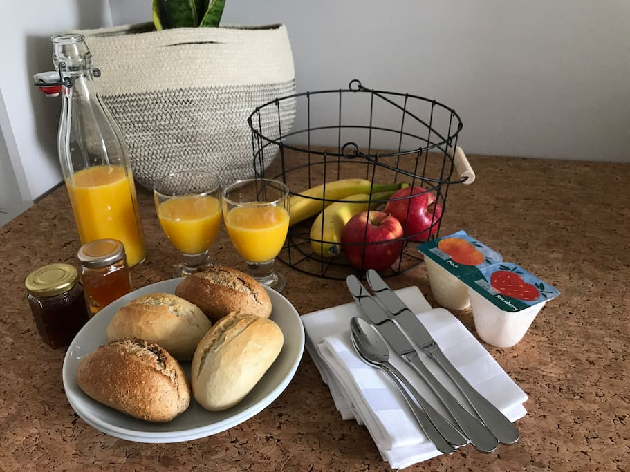 Yummy breakfast basket delivered to your room with warm rolls, fruit, yoghurts and orange juice.