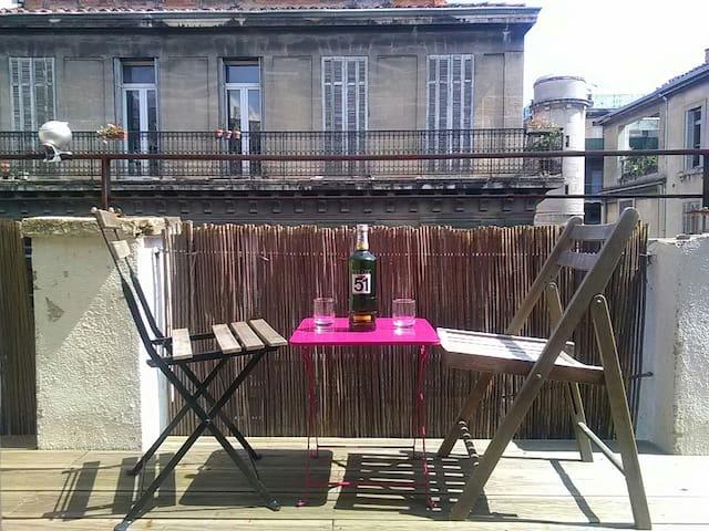 """Terrasse ensoleillée """"un nid en ville"""""""