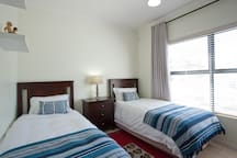 Second bedroom with two single beds