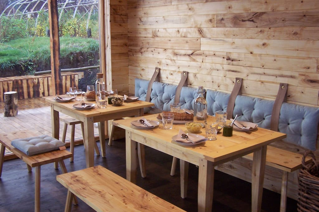 Enjoy a meal in our new café made of wood from the farm