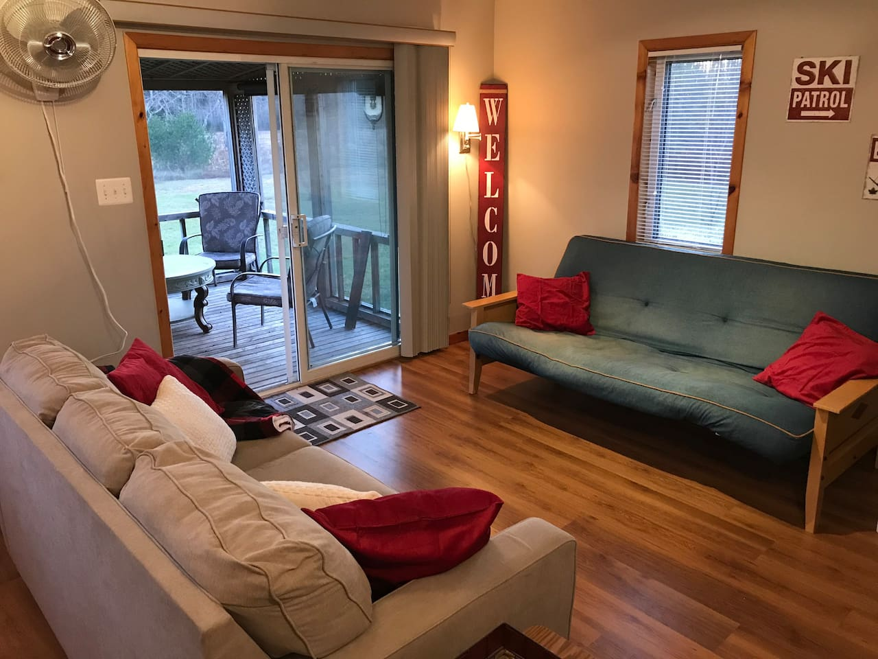 Pull out couch plus comfy futon in main living area.