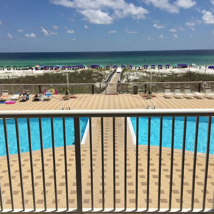 Your view of the pool and the beautiful Gulf of Mexico from your balcony