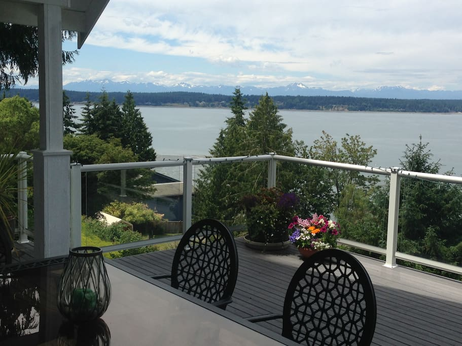 Enjoy dinner outside on the deck with a view of the Olympics