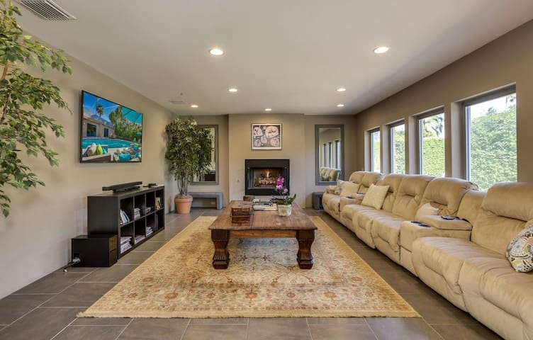 Relax on 7 recliners next to the gas fireplace in the well-appointed living room.