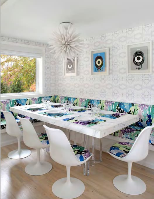 Eat-in kitchen with marble tables and countertops, Missoni fabrics, and fine art