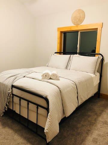 Bedroom # 4 features a queen bed and plenty of storage for your belongings.