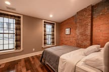 Exposed brick in the second floor bedroom