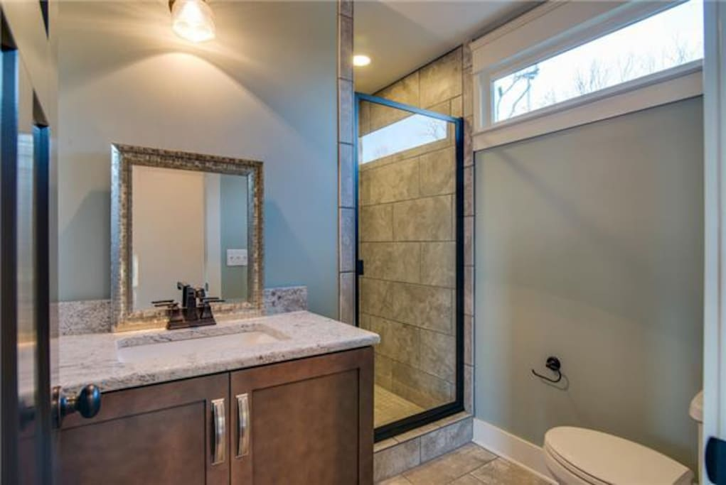 THis is the full bathroom on the fourth floor with the garage door. The bonus room.