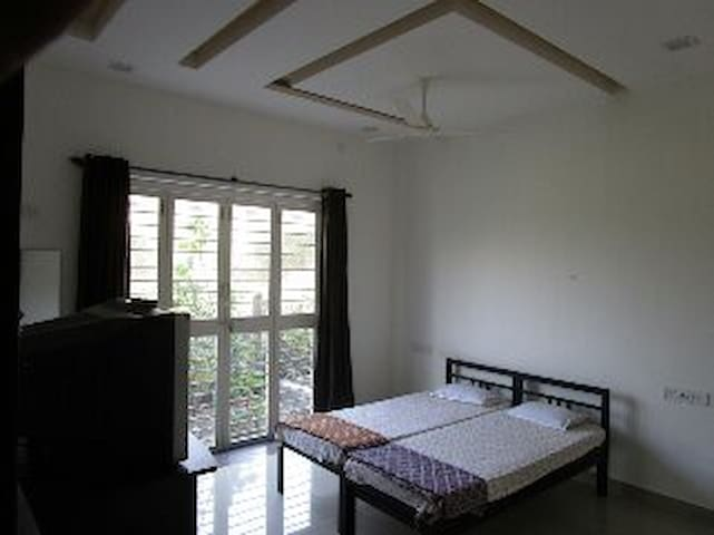 non ac big room with small garden