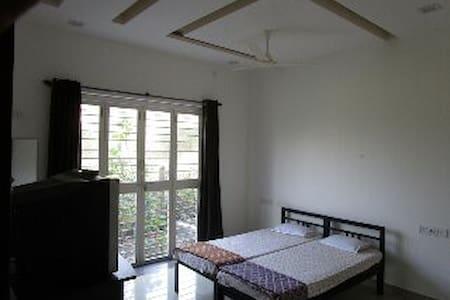 non ac big room with small garden - Kolhapur
