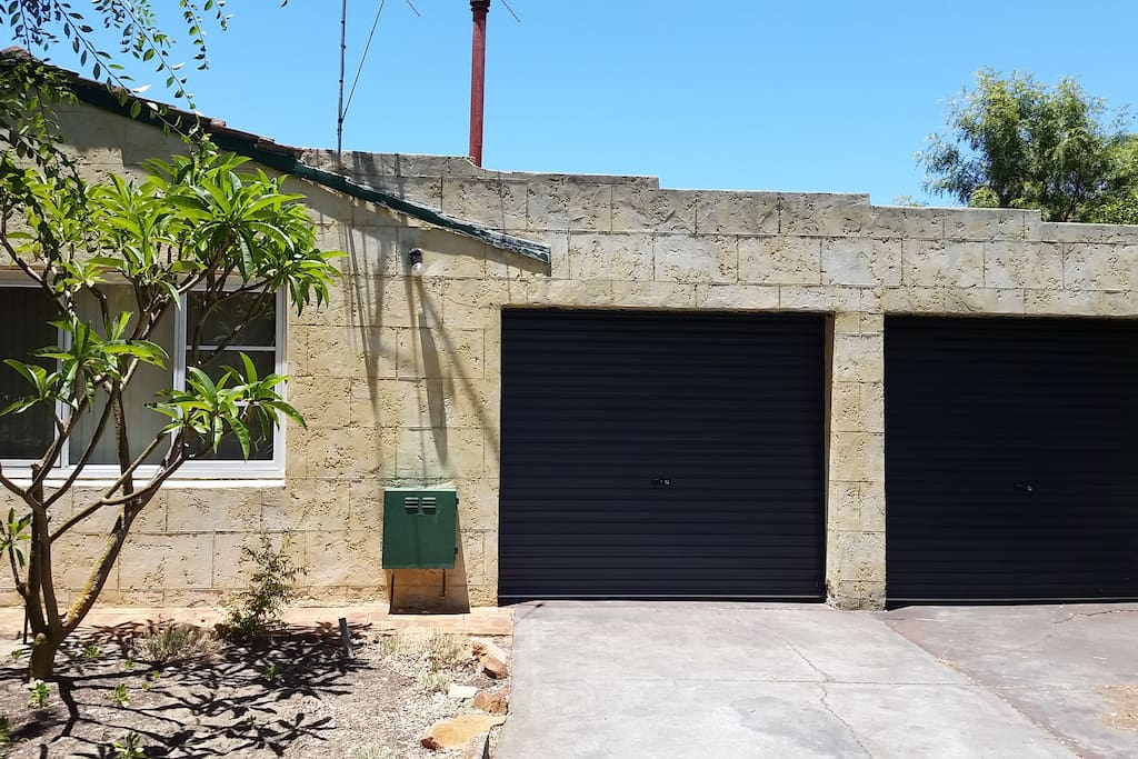 2 lockup roller door garages fits small cars only