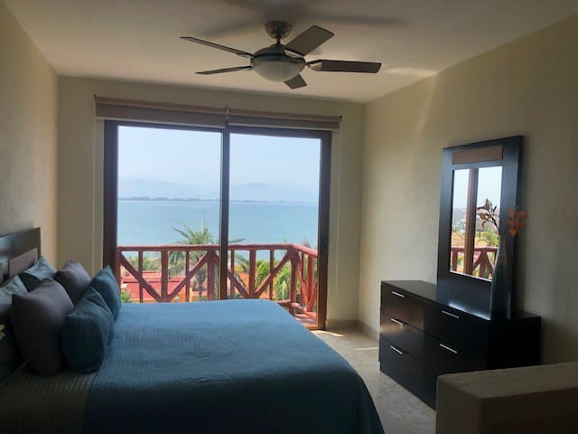 Master Bedroom #2 with private full bathroom and king bed and bonus private balcony overlooking the bay