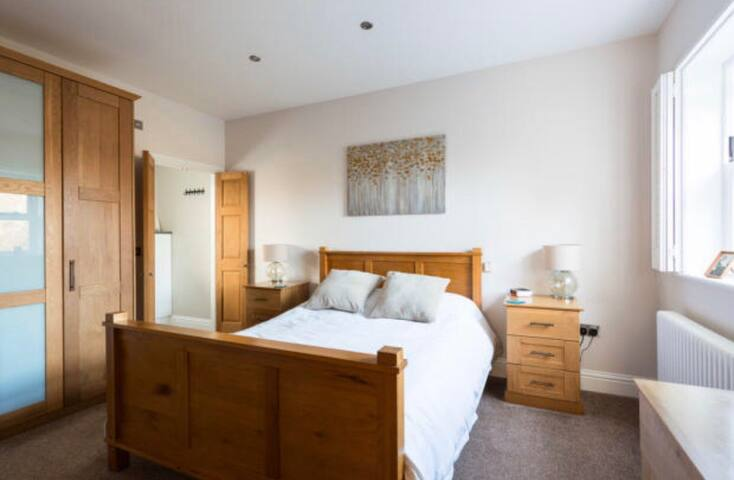Master bedroom with double bed,double wardrobe,drawers and en suite