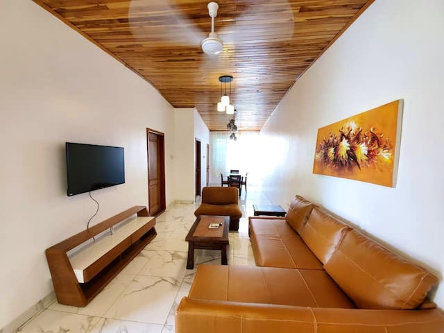 Living room with flat screen tv.