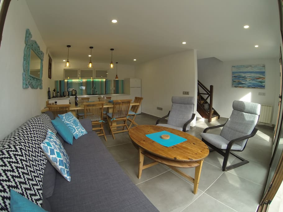 Modern open-plan living area with stairs leading upstairs to all 3 bedrooms/bathrooms and large roof terrace.
