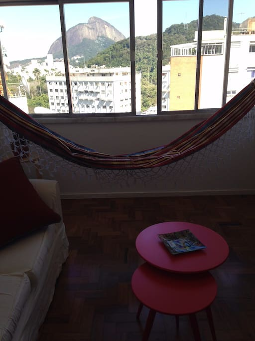 inviting hammock in spacious living room with view to Ipanema and the Atlantic Rainforest
