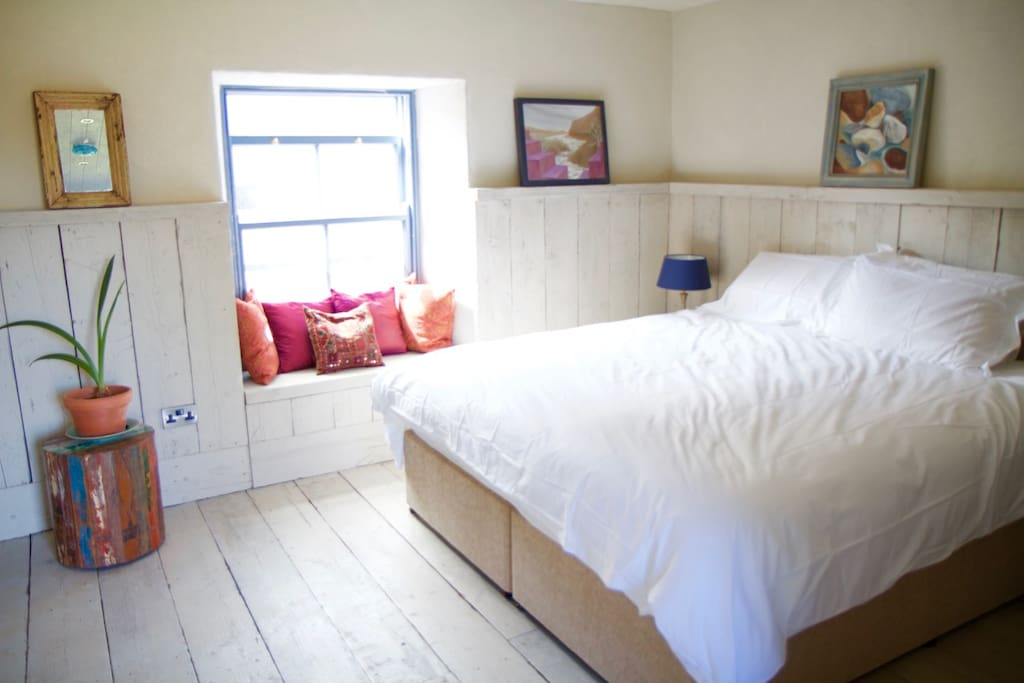 Stay right on the courtyard in The Old Dairy, with superking sized bed and reclaimed wooden panelling.