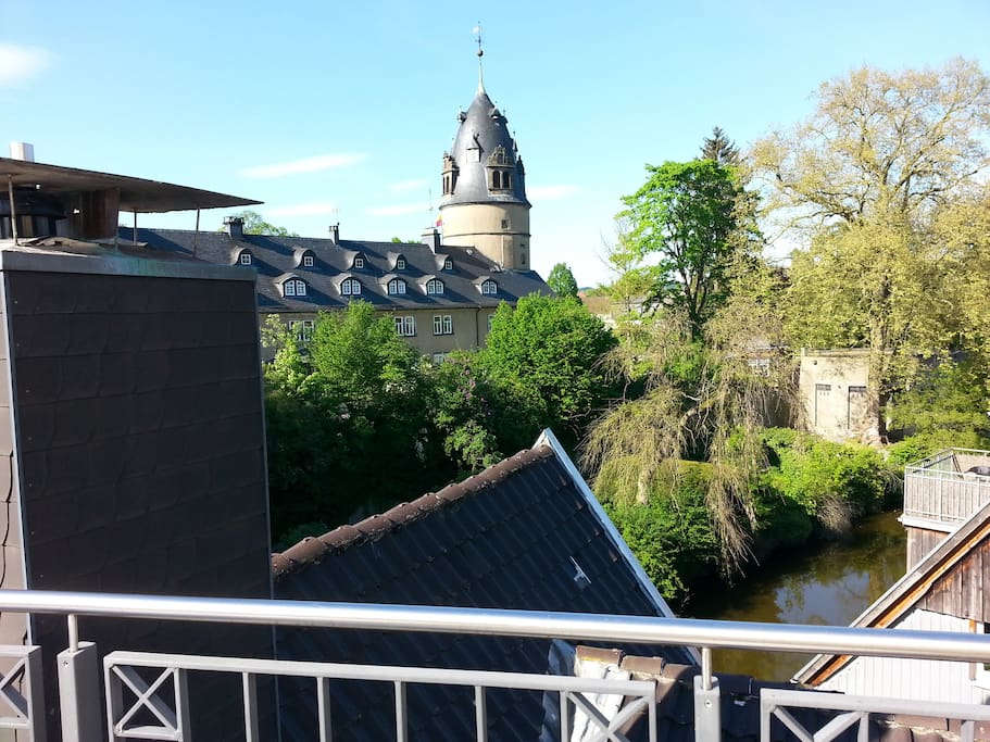 Balcony view on Detmold castle and the little river