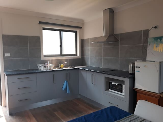 Nice sized kitchen with cook top and a microwave /conventional oven for your cooking needs. Kettle and toaster included too