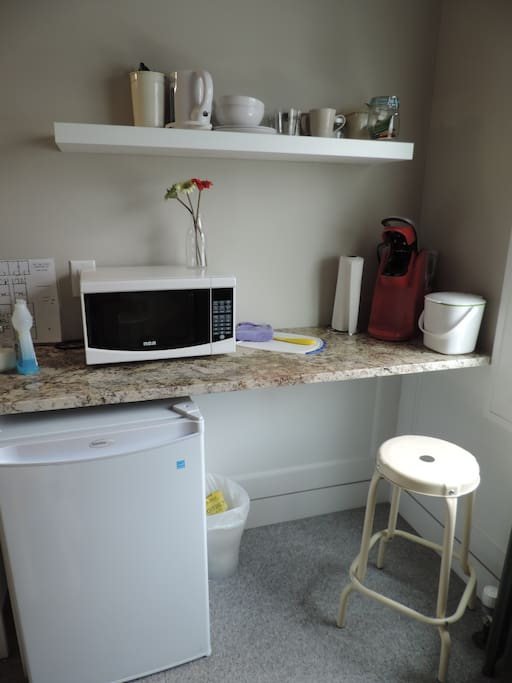 Kitchenette with microwave, coffee maker and kettle