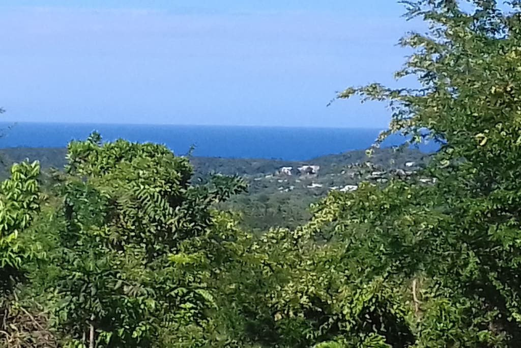 View of beautiful country mountain and caribbean sea