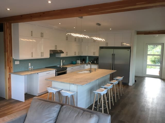The kitchen island seats 6 people