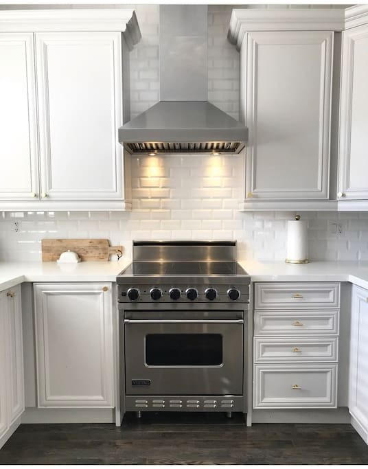 Renovated kitchen with high end appliances and island seating for 3
