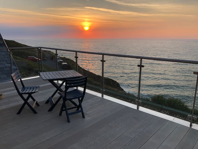 The summer gives us a lot of amazing sunsets over the sea. This photo is from the top balcony that you can walk up to and use. It's outside my home office that I'm usually in during the day.