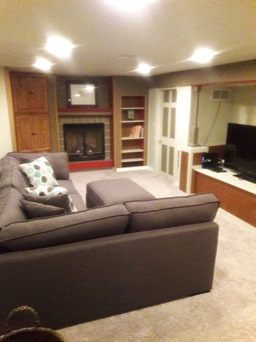 Basement Living Room. TV and gas fireplace.