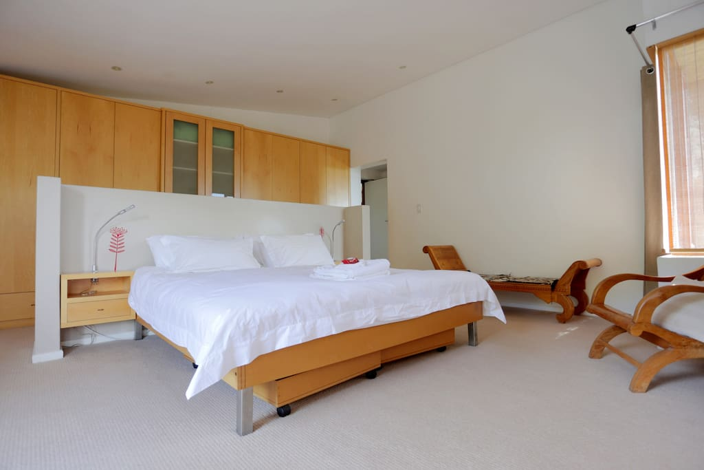 Master bedroom with King size bed opening onto private balcony with stunning views of the mountains and beach