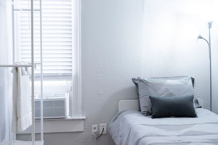 This room is complete with an AC unit to accommodate you in any weather.