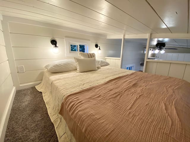 Above the bunk room is the queen bed loft.