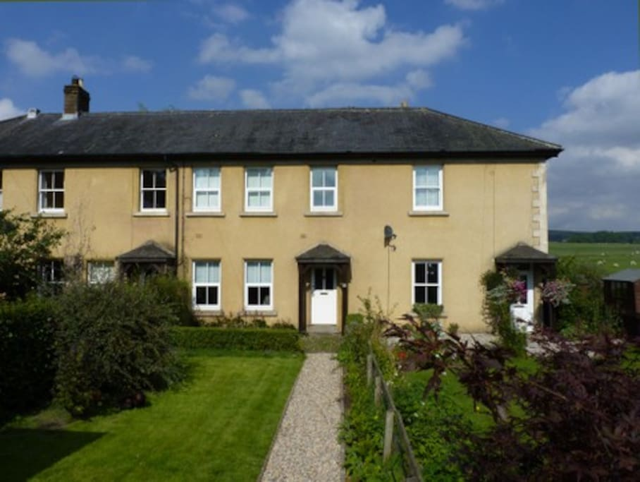 The cottage is in a terrace with three other houses.