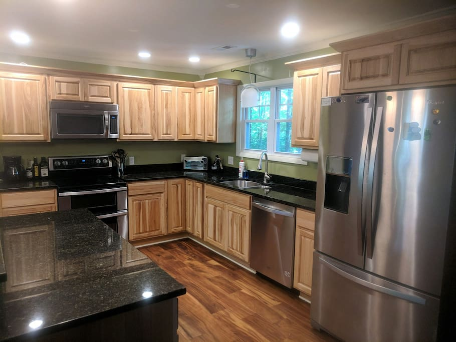 Fully stocked gourmet kitchen with plenty of counter space including a large island.