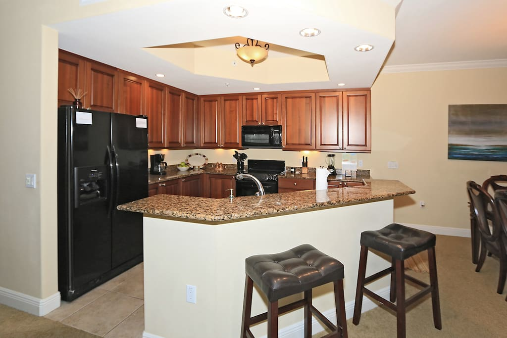 Granite Kitchen and Upgraded Appliances in this fully stocked kitchen