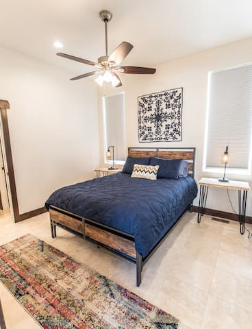 Master bedroom (just off the main living area).  Queen bed with memory foam mattress.  Custom end tables made with local wood.