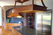 Kitchen with ovens, stovetop, grill, microwave, dishwasher etc and is fully stocked for large groups.