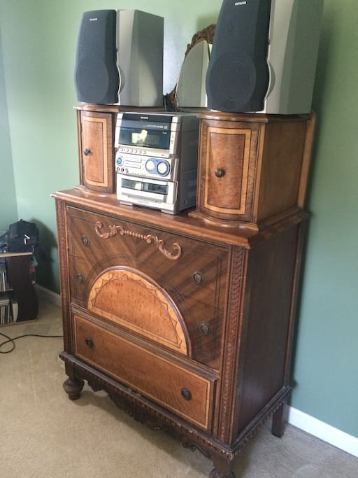 Dresser and CD player in bedroom