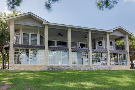 Dog-friendly, waterfront home w/ an indoor pool, dock, & boathouse w/ boat lift