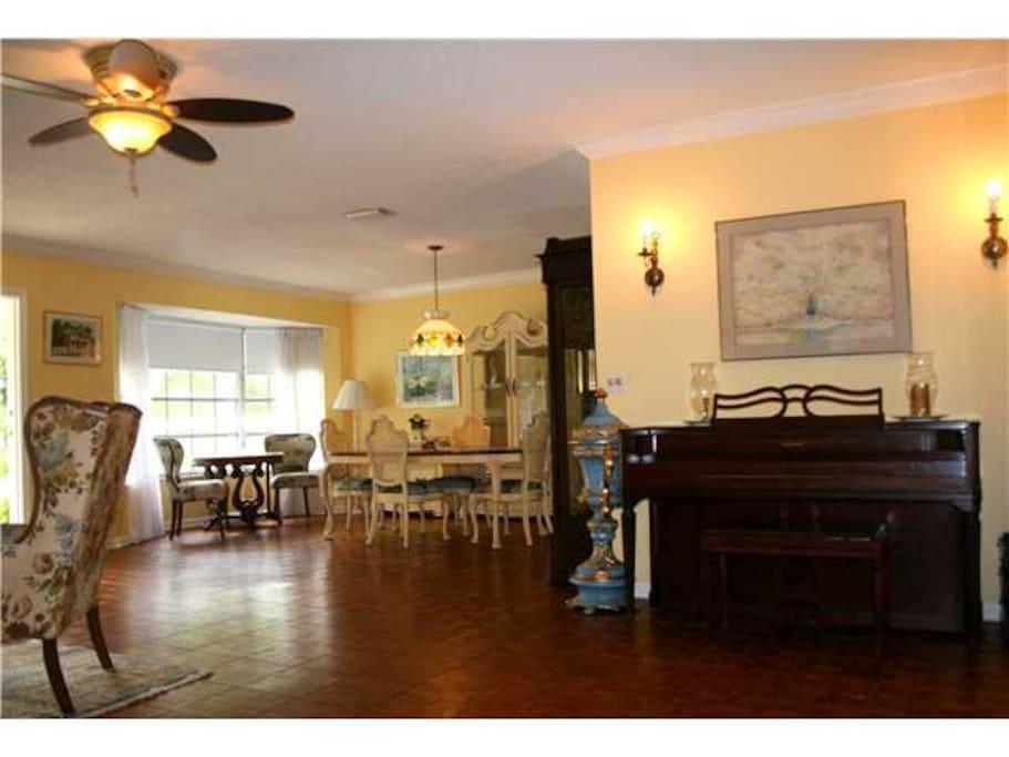 Anyone play piano? Teak hardwood floors throughout.