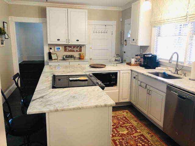 Beautiful Kitchen to enjoy cooking in! Stainless Steel appliances, Regular coffee and Keurig coffee maker, toaster, microwave, Belgium Waffle maker, Panini Press, Crockpot, pots and pans, plenty of serving sets and utensils, etc!