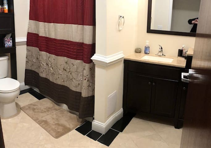 Our shared bathroom with room to store your toiletries.