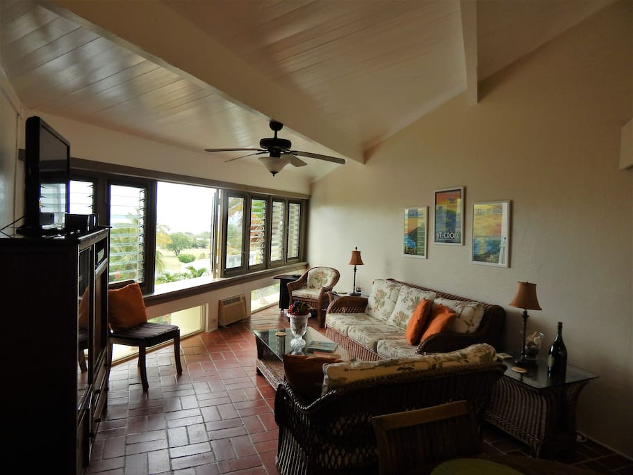 living room with views of the Caribbean and the golf course