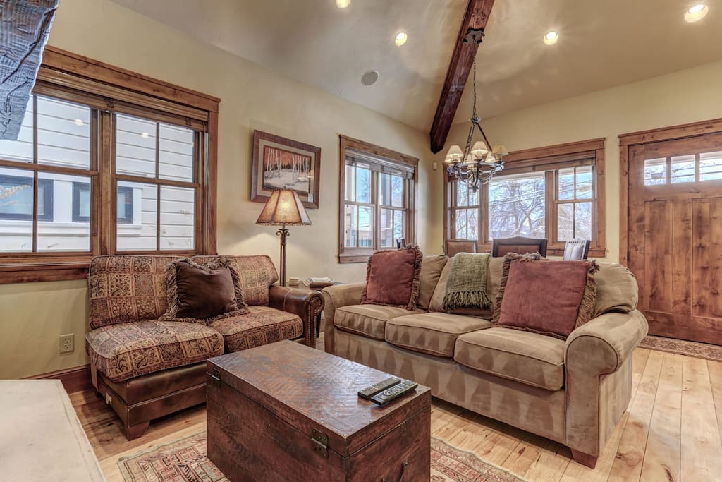 Living room with pullout queen sleeper, gas fireplace, large HD TV/DVD